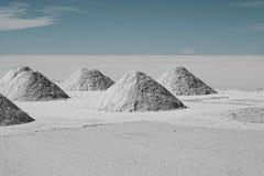 Drying Hand-shoveled Salt Piles on Bolivia`s Salar de Uyuni Royalty Free Stock Images