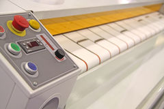 Drying and ironing rolling press. Automatic drying and ironing rolling press Stock Image