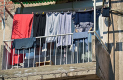 Drying laundry on a clothesline Stock Images