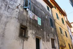Laundry hanging on a Tuscan street stock photo