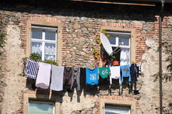 Drying laundry. On the laundry line at the house facade Stock Photography