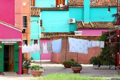 Drying laundry in the middle of the courtyard  of Burano Island Royalty Free Stock Photos
