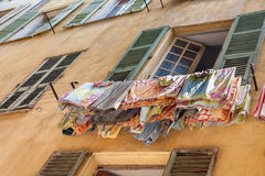 Drying laundry outside the window Royalty Free Stock Photos