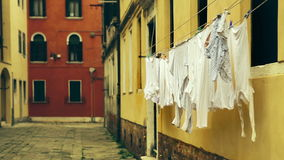 Drying laundry waving at the old italian street, Venice.  stock video footage