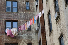 Drying linen. And clothes on the rope outside the window royalty free stock photo