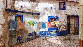 The drying linen on the street Stock Photo