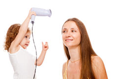 Drying mom's hair Royalty Free Stock Image