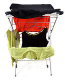 Drying rack. Clothes hanging on a drying rack - alternative to a dryer Stock Images