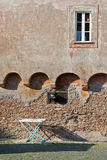 Drying rack under an ancient wall in italy. A drying rack under a window on an ancient wall in ostia, italy Royalty Free Stock Photos