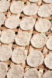 Drying rice cakes, Myanmar Royalty Free Stock Image