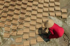Drying roof tile. The final process of making tile from clay traditionally from Indonesia is drying the tile Royalty Free Stock Images