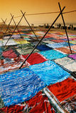 Drying sari in Agra, India. Colorful sari are dryed on the sand bank of river Yamuna in Agra in India Royalty Free Stock Photo