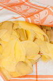 Drying sliced potato chips on the kitchen towel Royalty Free Stock Photos