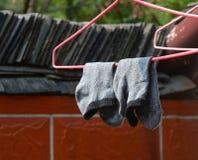 Drying socks hanging Stock Photos