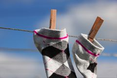 Drying socks on the rope Royalty Free Stock Image