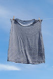 Drying of striped shirt. Stock Photos