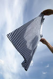 Drying of striped shirt. Royalty Free Stock Image