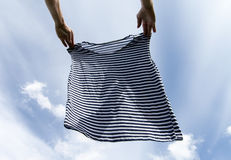 Drying of striped shirt. Royalty Free Stock Photos
