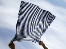 Drying of striped shirt. Stock Photo