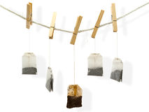 Drying tea bags. At the peg against white background Royalty Free Stock Photography
