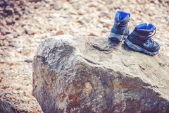 Drying Trekking Shoes. On the Large Stone. Trail Hiking Concept Photo stock photo