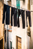 Drying trousers in a narrow street Stock Image