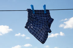 Drying Underwear Child. Picture drying Underwear Child on a string. On a clear summer day Royalty Free Stock Images