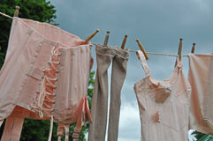 Drying underwear on clothesline. Drying old-fashoined tights, bra and corsets on clothesline Stock Images