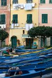 Drying the Washing. Clothes and linen hung out to dry, with small fishing boats in the foreground, in the quaint fishing village of Riomaggiore, Cinque Terre Stock Images