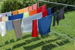 Drying after washing. Sheets and clothes dried on the ropes stock photos