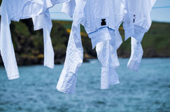 Drying the washing outdoor on a line. Close to the ocean stock photo