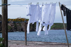 Drying the washing outdoor on a line. Close to the ocean royalty free stock images