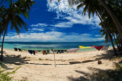 Drying washing,philippines. A washing line with clothes drying in the breeze on a beach in the philippines Stock Photography
