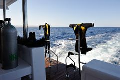Drying of wet diving suits Stock Photos