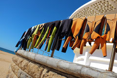 Drying Wet Suits Stock Images