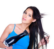 Drying of woman's long hair Stock Photo