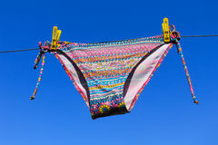 Drying woman swimsuit against blue sky Stock Photos