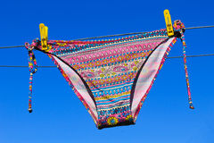 Drying woman swimsuit against blue sky Royalty Free Stock Photography
