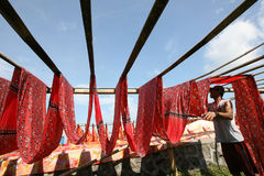 Drying. Workers are drying fabric that has been colored in Sukoharjo, Central Java, Indonesia Stock Image