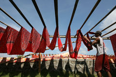 Drying. Workers are drying fabric that has been colored in Sukoharjo, Central Java, Indonesia Stock Photography