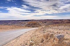 Drylands. Deserted  road in Jordanian drylands ; ruins of castle on hill Stock Photos