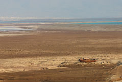 Dryness by the Dead Sea. Old boat by the Dead Sea showing where the water once was Royalty Free Stock Photography