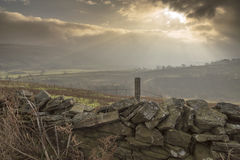 Drystone wall and sunburst. Off the A686 above Haltwhistle Northumberland United Kingdom Royalty Free Stock Photography