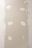 Drywall. Board with patches of mud covering seams and screw heads Stock Images