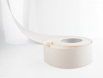 Drywall. Or sheetrock seam tape on a white reflective background Royalty Free Stock Photo