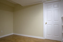 Drywall in Basement Renovation. A newly constructed room in a basement is made cheerful with brightly coloured paint and a cork floor. Cork is an environmentally Stock Images