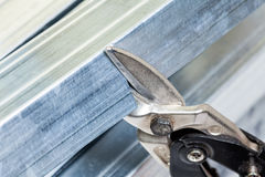 Drywall frame steel stud cutting with snips Royalty Free Stock Photo