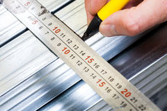 Drywall frame steel stud measuring and marking Royalty Free Stock Photos