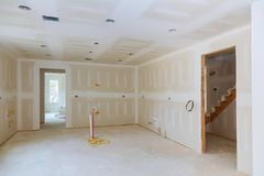 Drywall is hung in kitchen room remodeling project. Drywall is hung in kitchen remodeling project Interior of apartment with materials during on the renovation Stock Photo