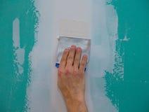 Drywall hydrophobic plasterboard trowel plastering seam Stock Image